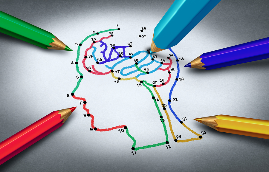Drawing of a brain featuring the colors of the Autism Awareness puzzle piece